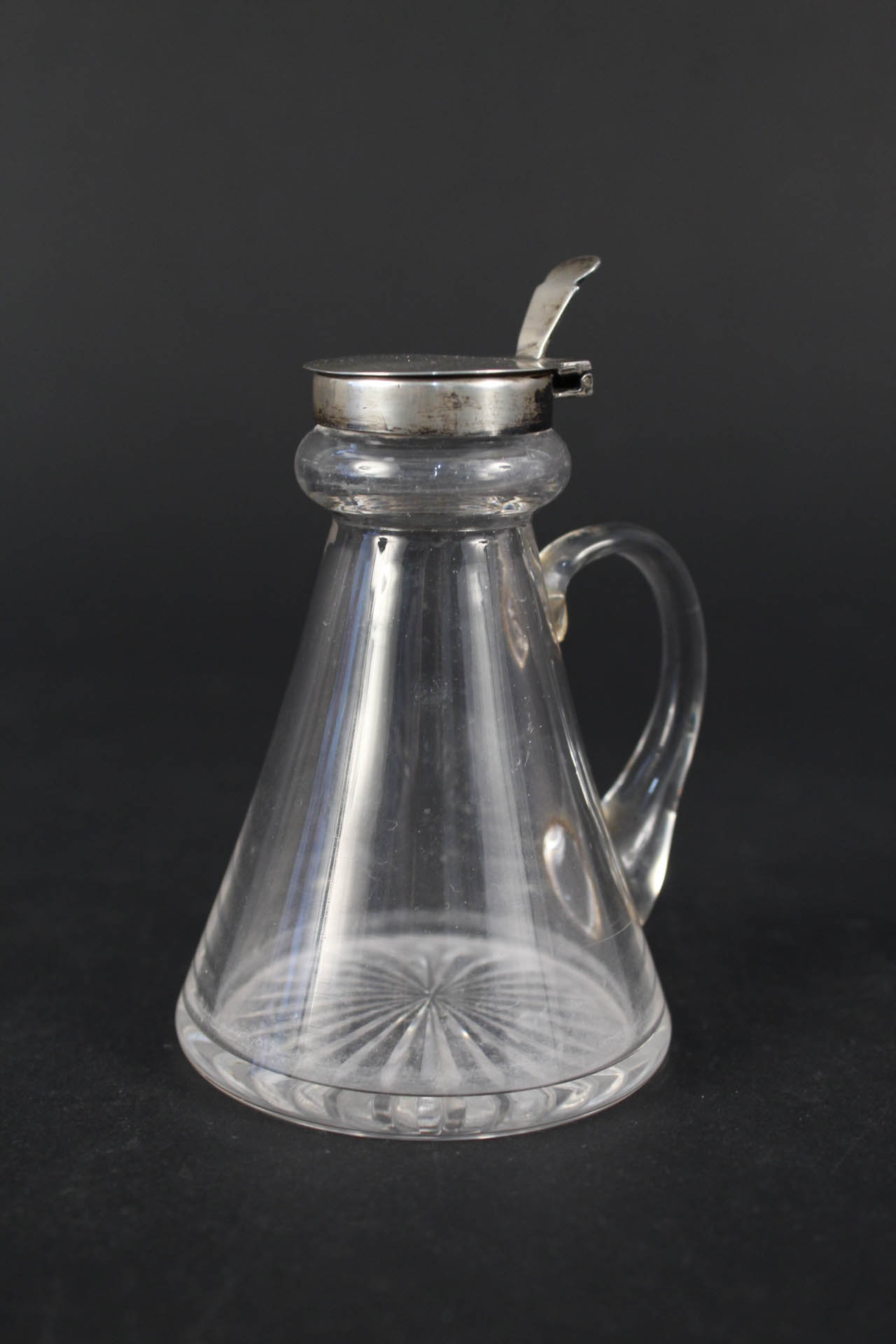 A silver topped cut glass whisky noggin,