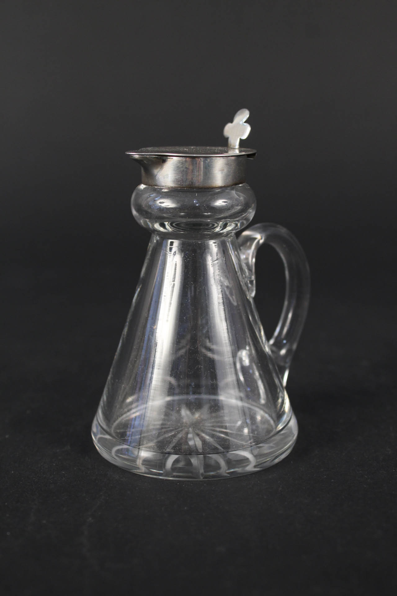 A silver topped glass whisky noggin,