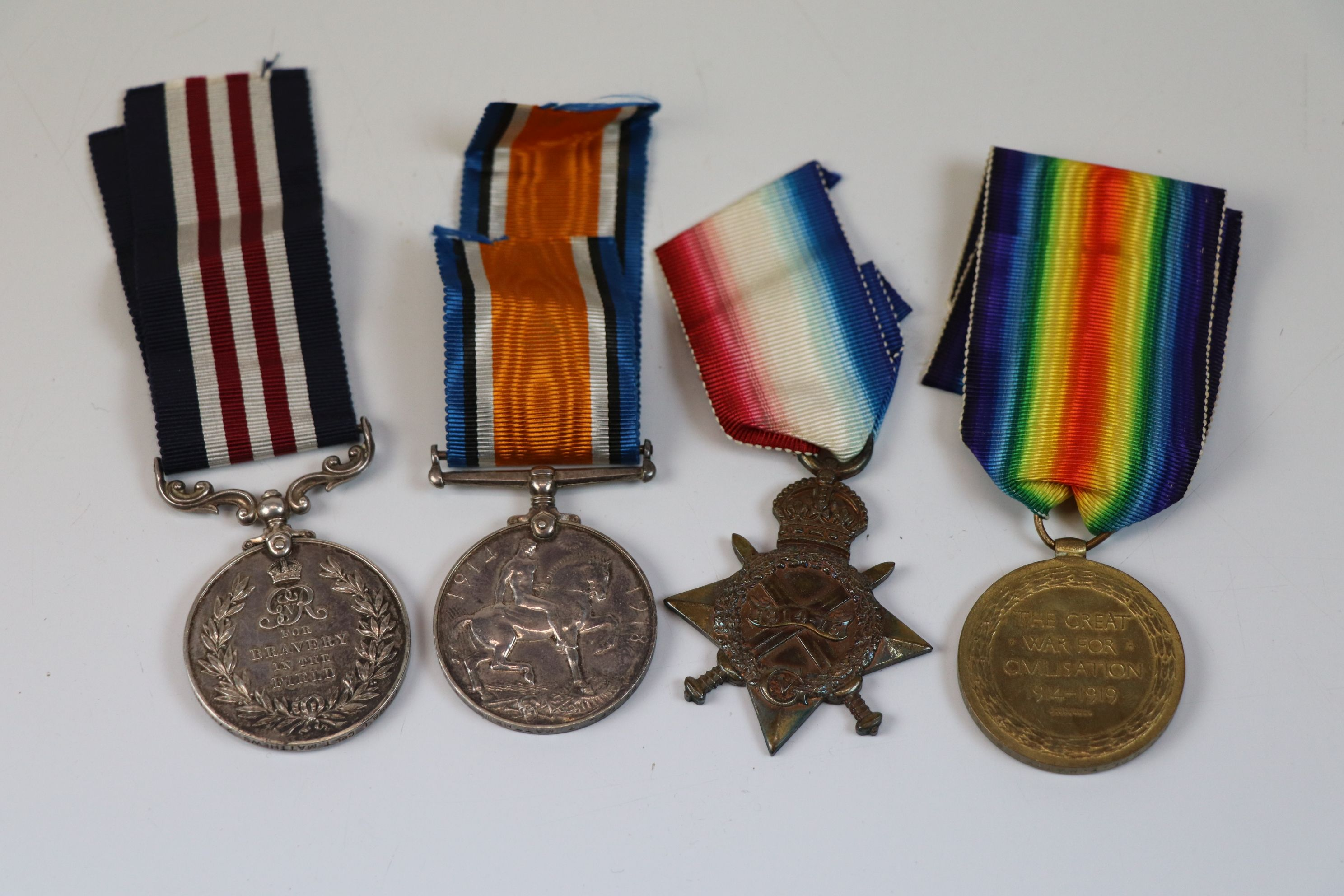 Lot 3 - A WW1 full size medal trio and Military medal issued to 12296 L. CPL. T. Matthews 2nd Royal