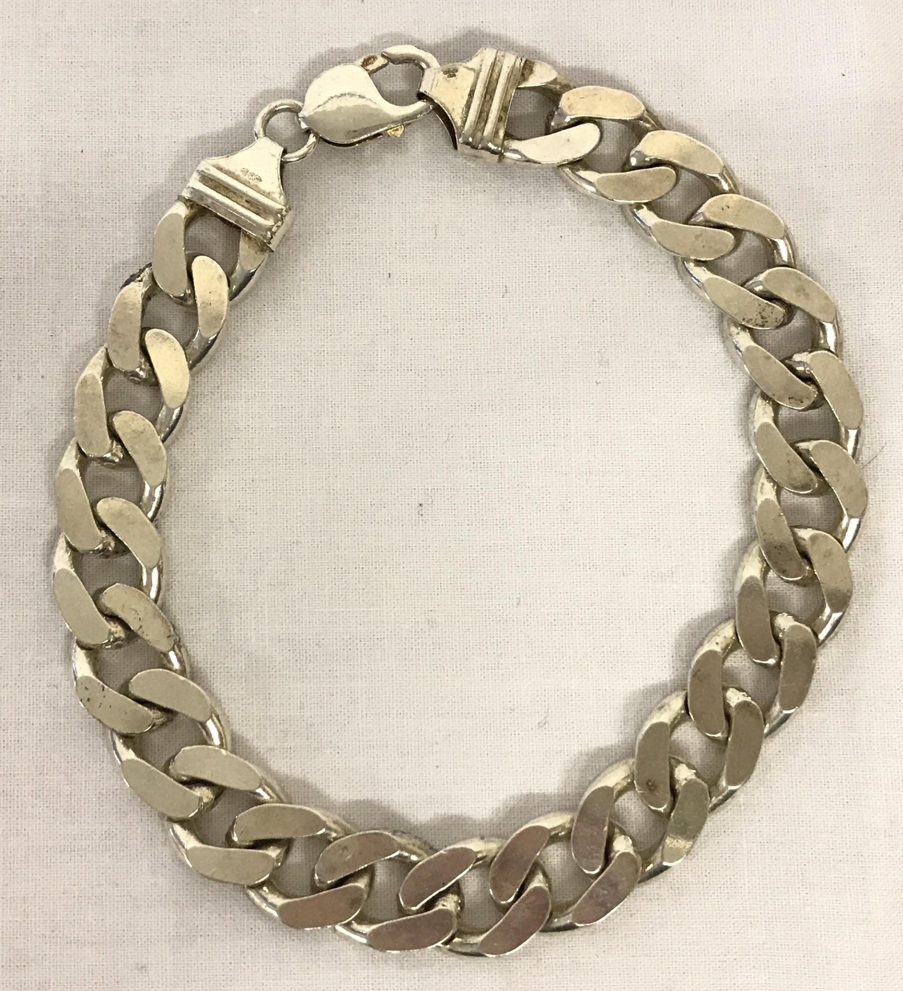 A modern white metal heavy curb chain bracelet with lobster clasp.