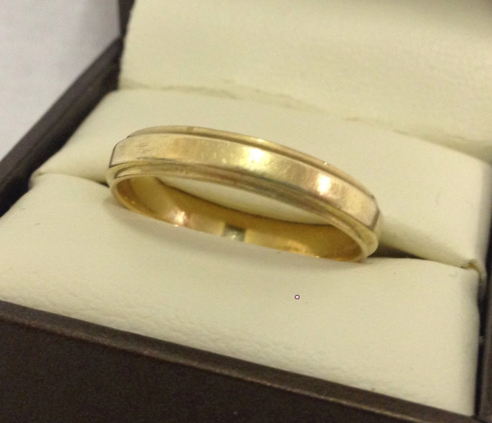 Lot 23 - A 14ct gold wedding band. Size U. Total weight approx. 3.8g.