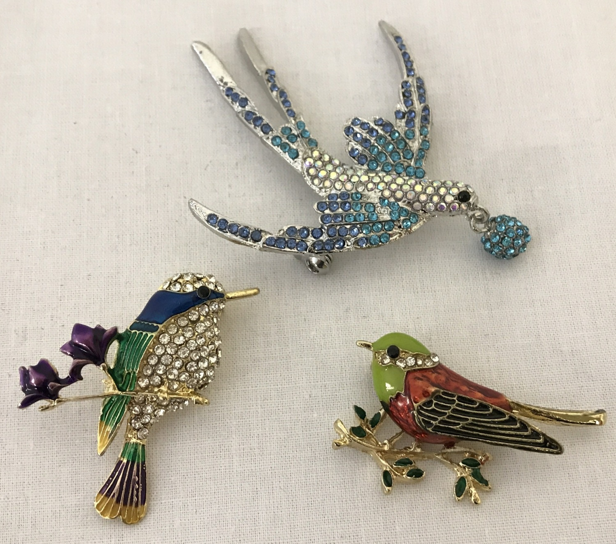 3 costume jewellery enamelled and stone set brooches in the shape of birds.
