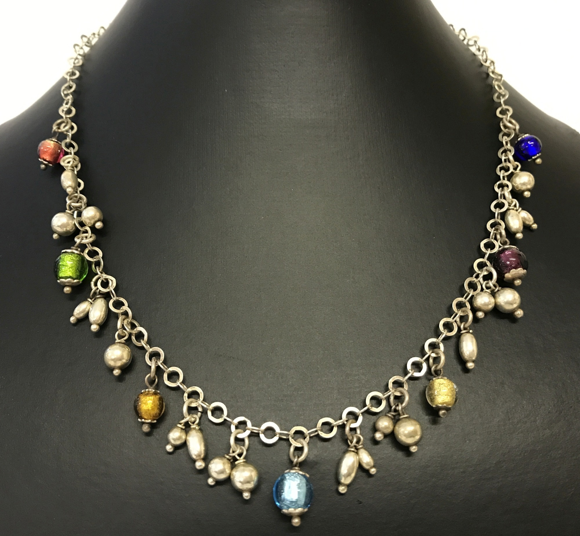 Lot 57 - A modern design necklace with metal and foil glass drop bead decoration.