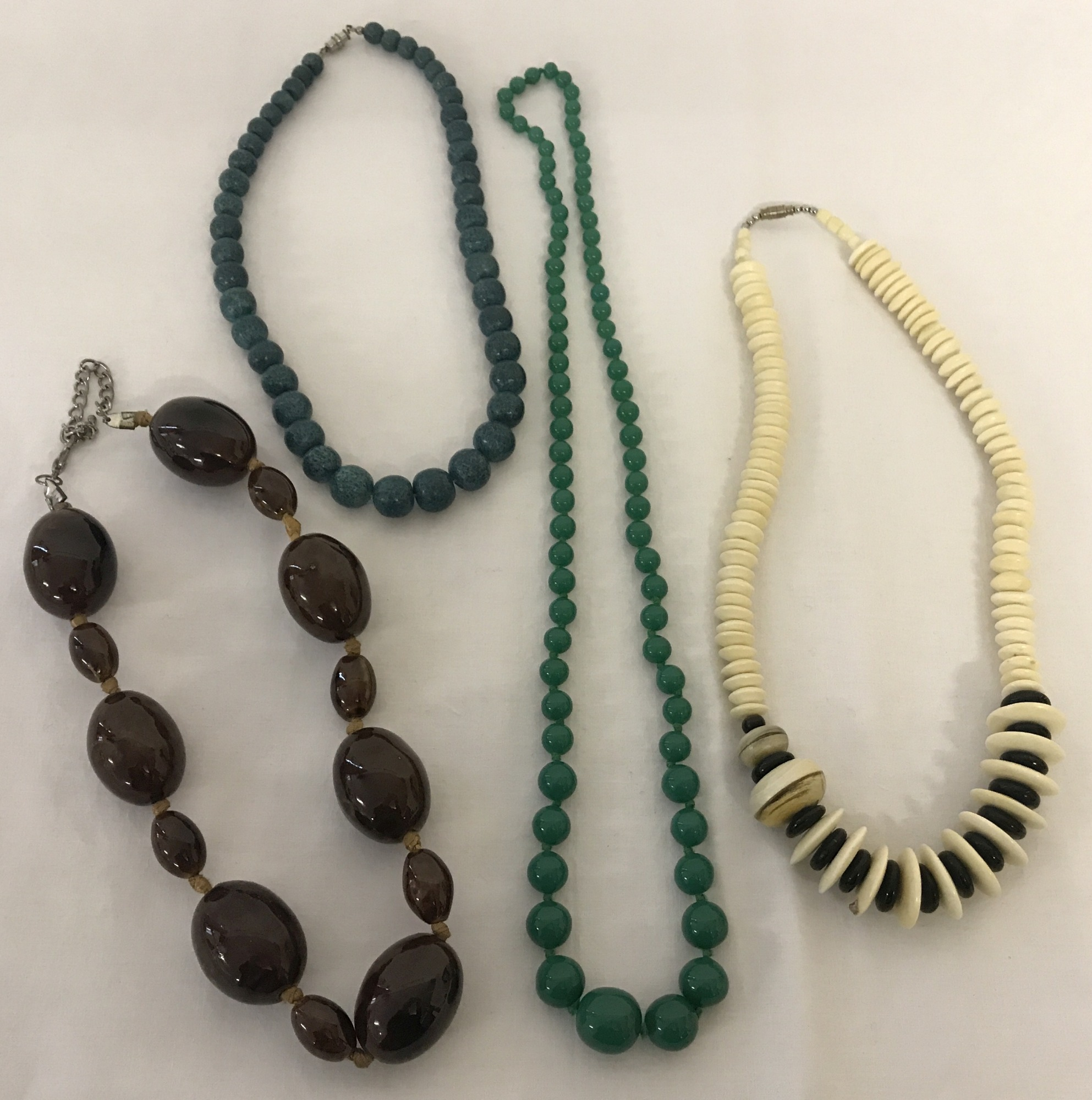 Lot 55 - A collection of 4 natural stone and glass bead dress necklaces.