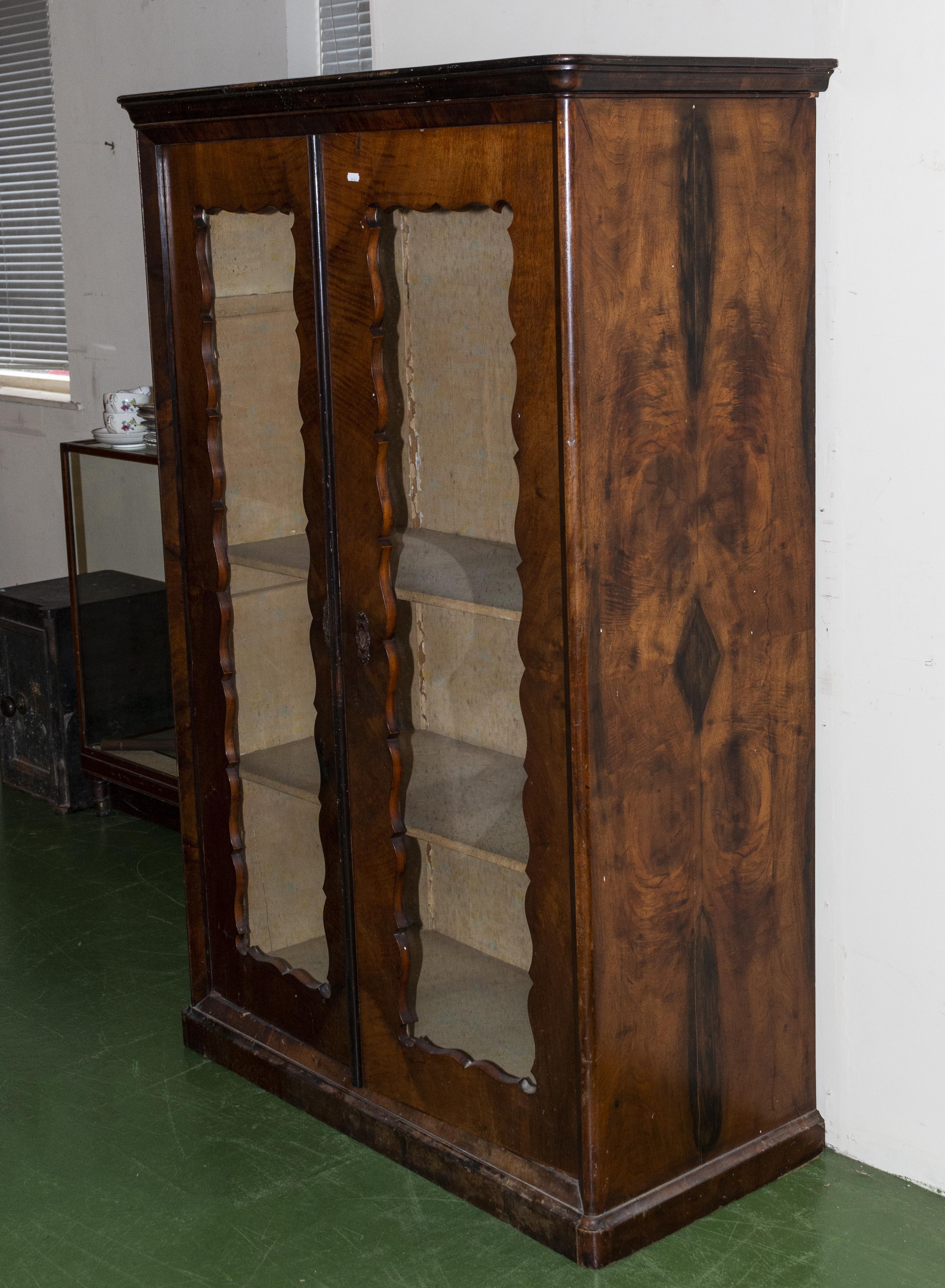 Lot 1 - A French walnut cabinet.