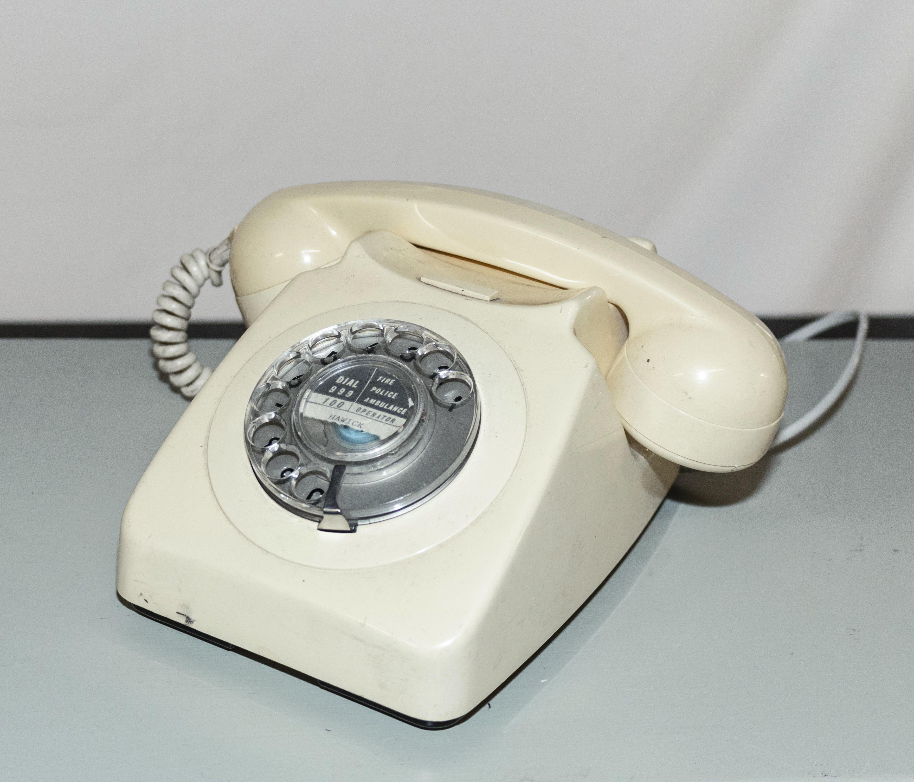 Lot 5 - A vintage ivory telephone.