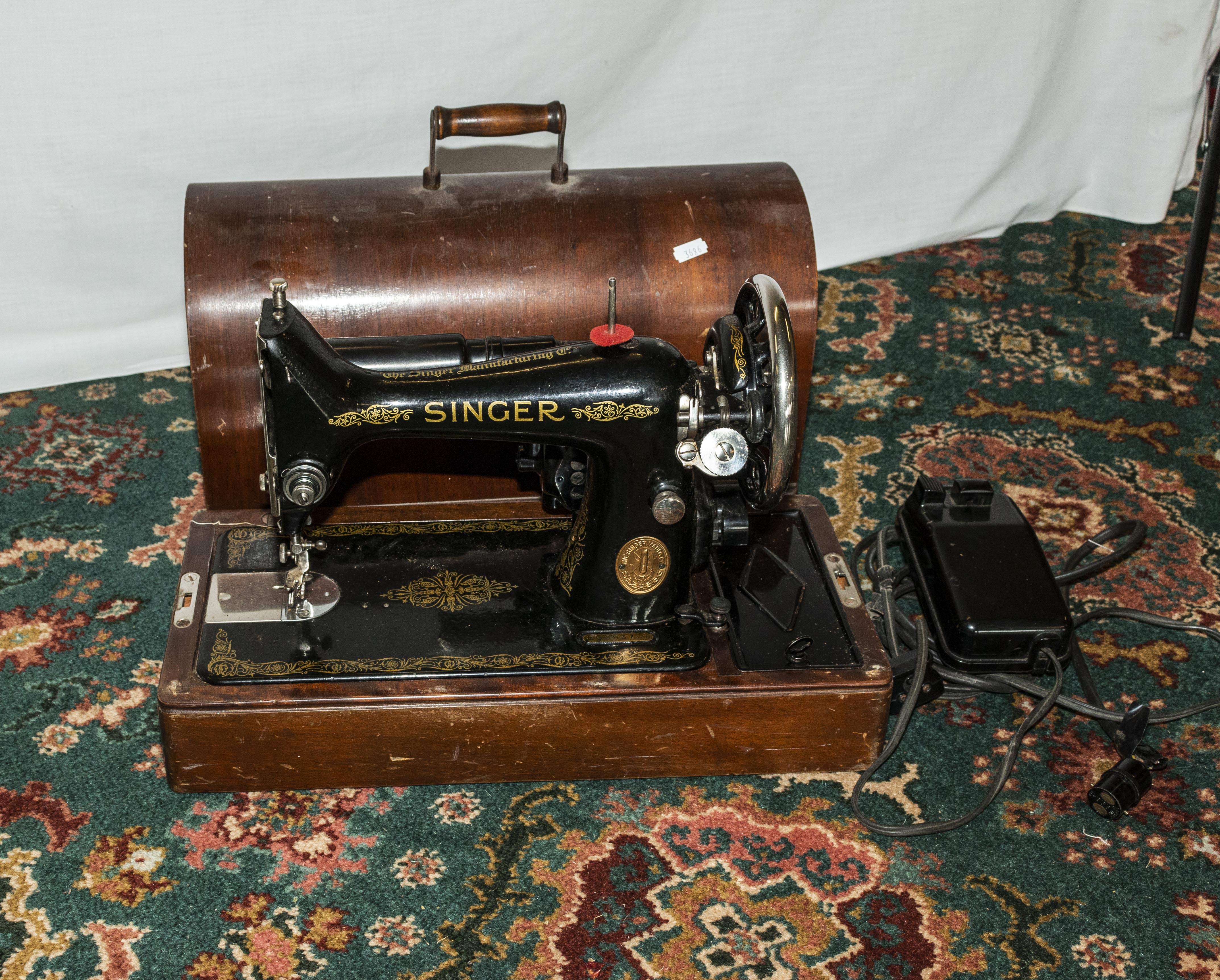 Lot 44 - A table top Singer sewing machine