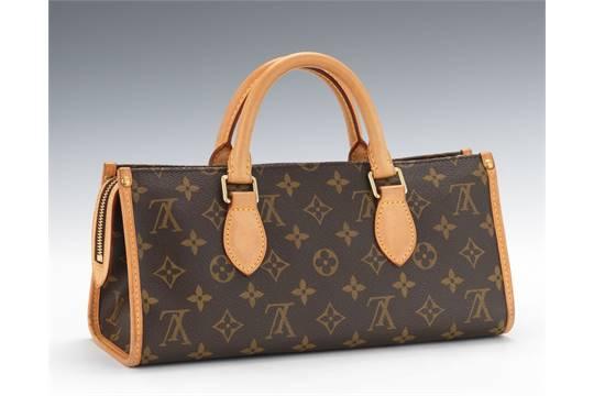 b3001c6ff2a8 Louis Vuitton Monogram Canvas Sac Triangle This unique bag was ...