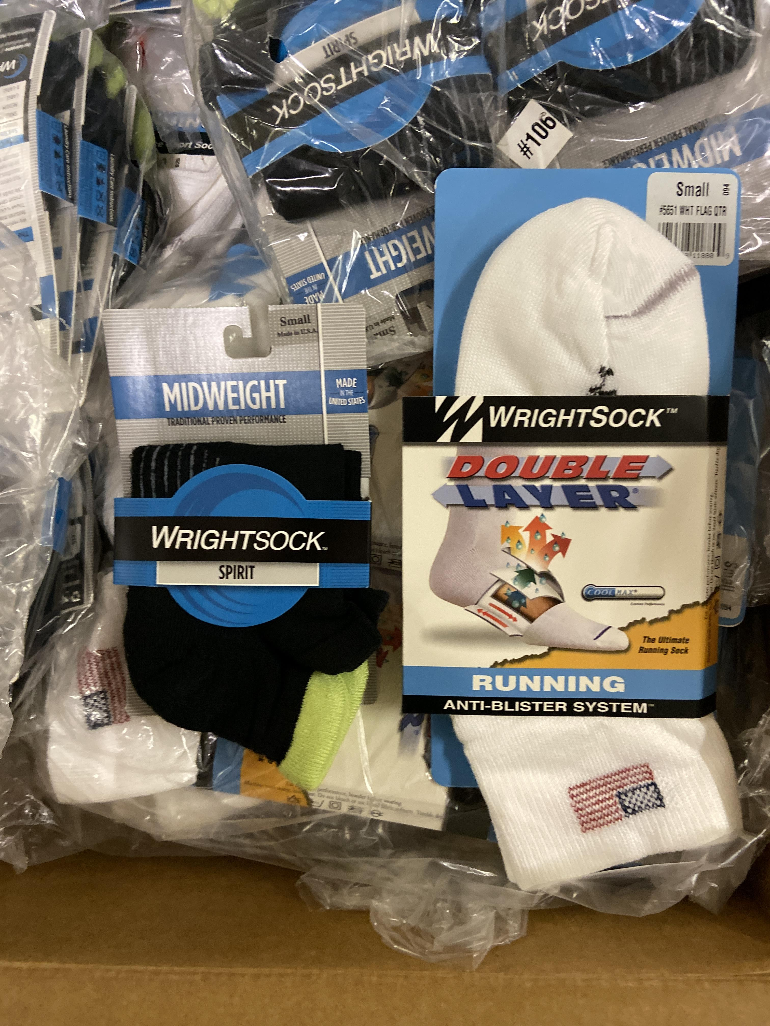 Lot 23 - 250+ packs of New Socks, Wrightsock Running and Midweight, Double Layer, White with USA Flag and