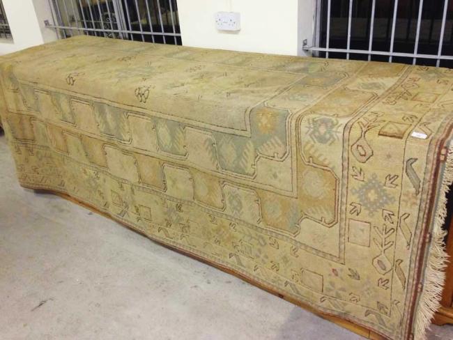 Lot 244 - A vintage Milas Turkish wool rug. 295 x 206cm (7.08m²).
