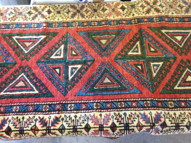 Lot 248 - A vintage turkish wool rug. 350 x 96cm (3.36m²).