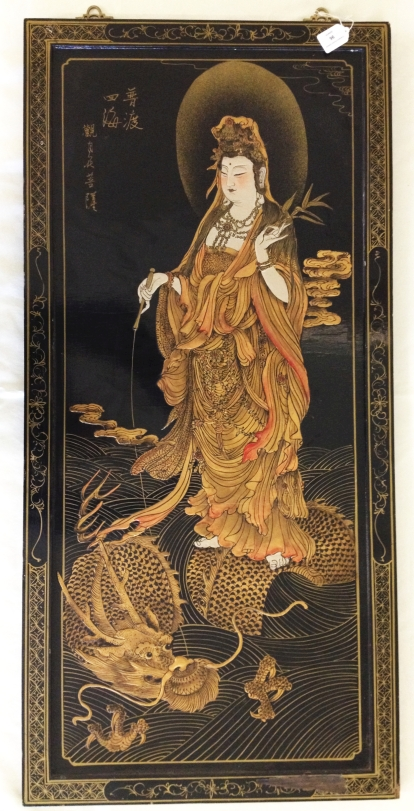 "Lot 96 - An oriental late 19th century black lacquer framed panel depicting Guanyin. 42 x 20"" (107 x 51cm)."