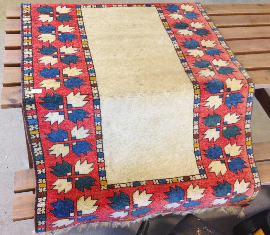Lot 250 - A vintage Canakkale Turkish wool rug. 142 x 96cm (1.36m²).