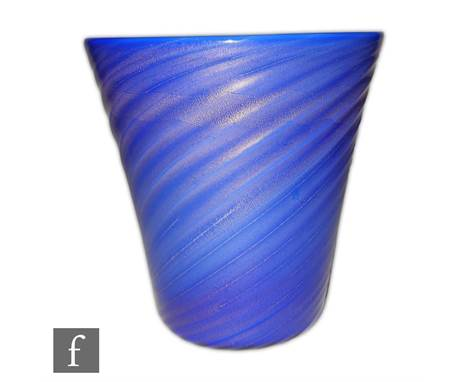 A Flavio Poli for Seguso Incamiciato glass vase of tumbler form cased in blue with gold aventurine over opal with a fine wryt