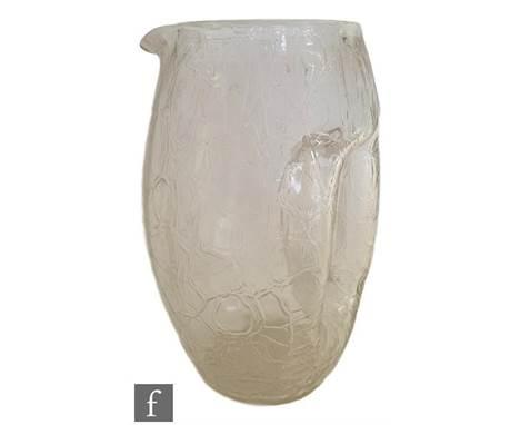 A Kralik barrel form jug with integral handle and a crackle glass finish after designs by Kolomon Moser, height 19cm.
