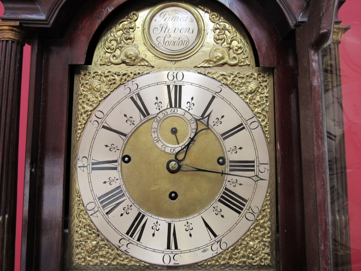 Lot 9001 - JAMES STEVENS; London: an 18th Century flame mahogany longcase clock with brass arched dial,