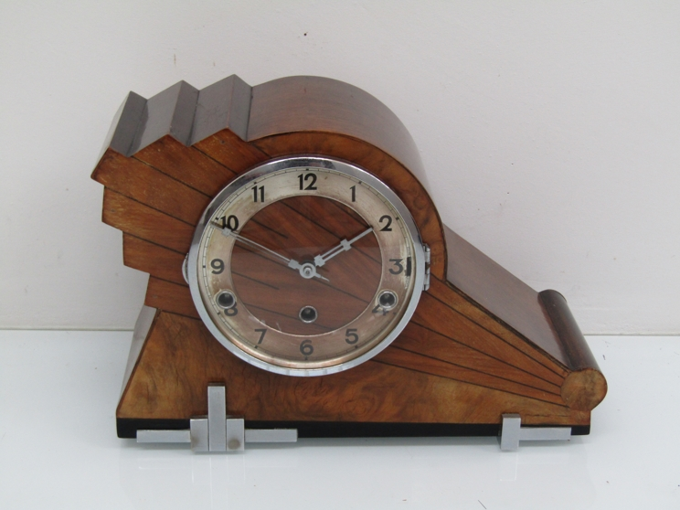 Lot 9048 - A 1930's walnut Art Deco striking and chiming mantel clock with silvered Arabic chapter ring,