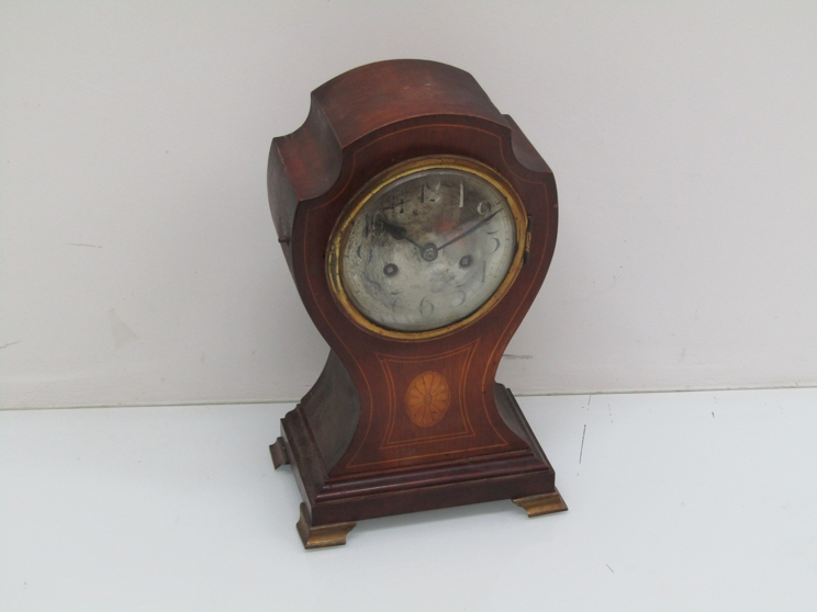Lot 9049 - An Edwardian mahogany and inlaid mantel clock for balloon form, silvered Arabic dial,