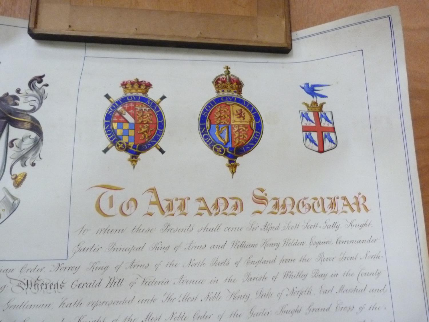 Lot 154 - COLLEGE OF ARMS.  Signed illuminated manuscript Grant of Arms on vellum to Gerald Hill, with two