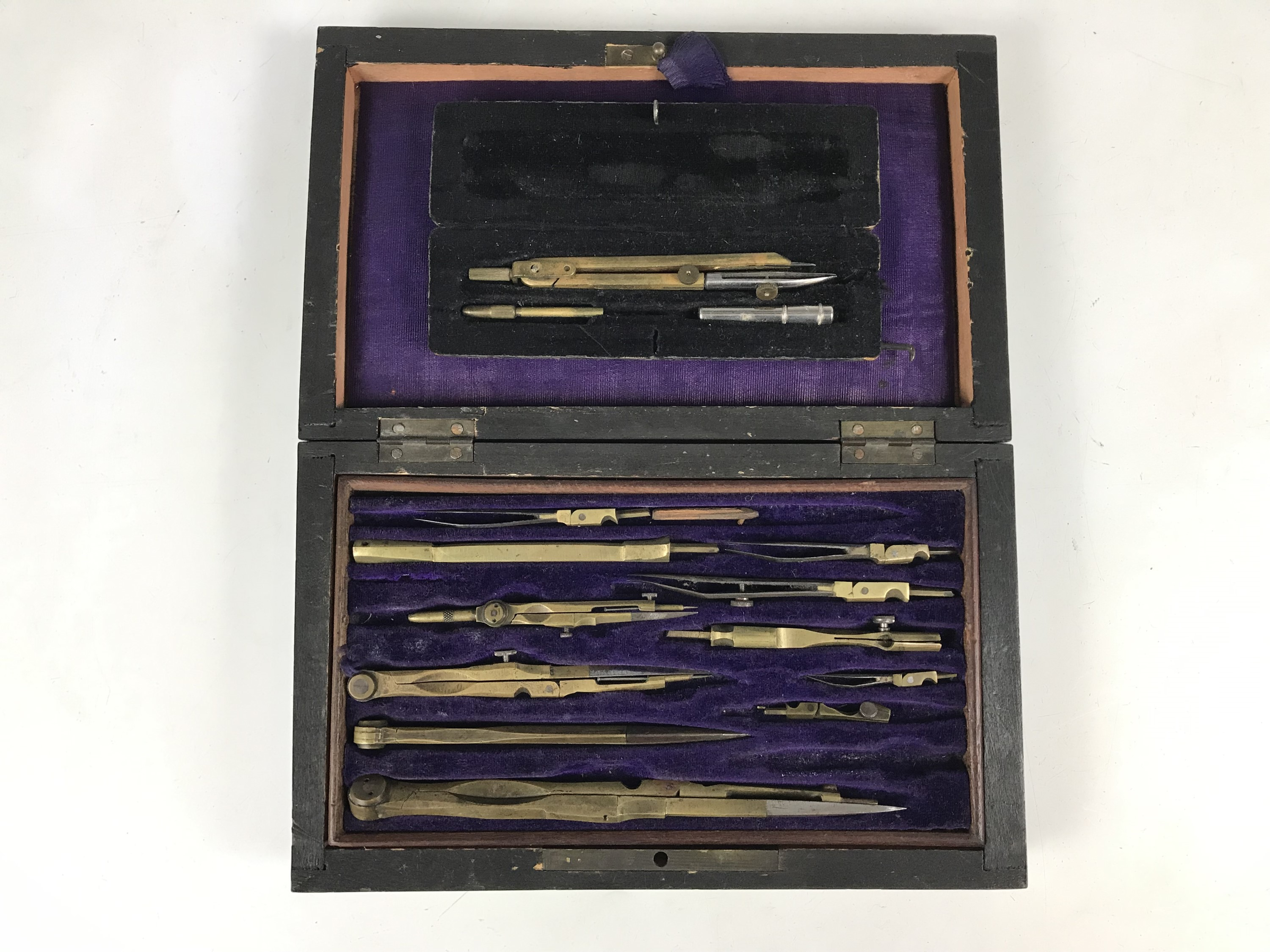 Lot 13 - A cased drawing instruments set together with a cased compass