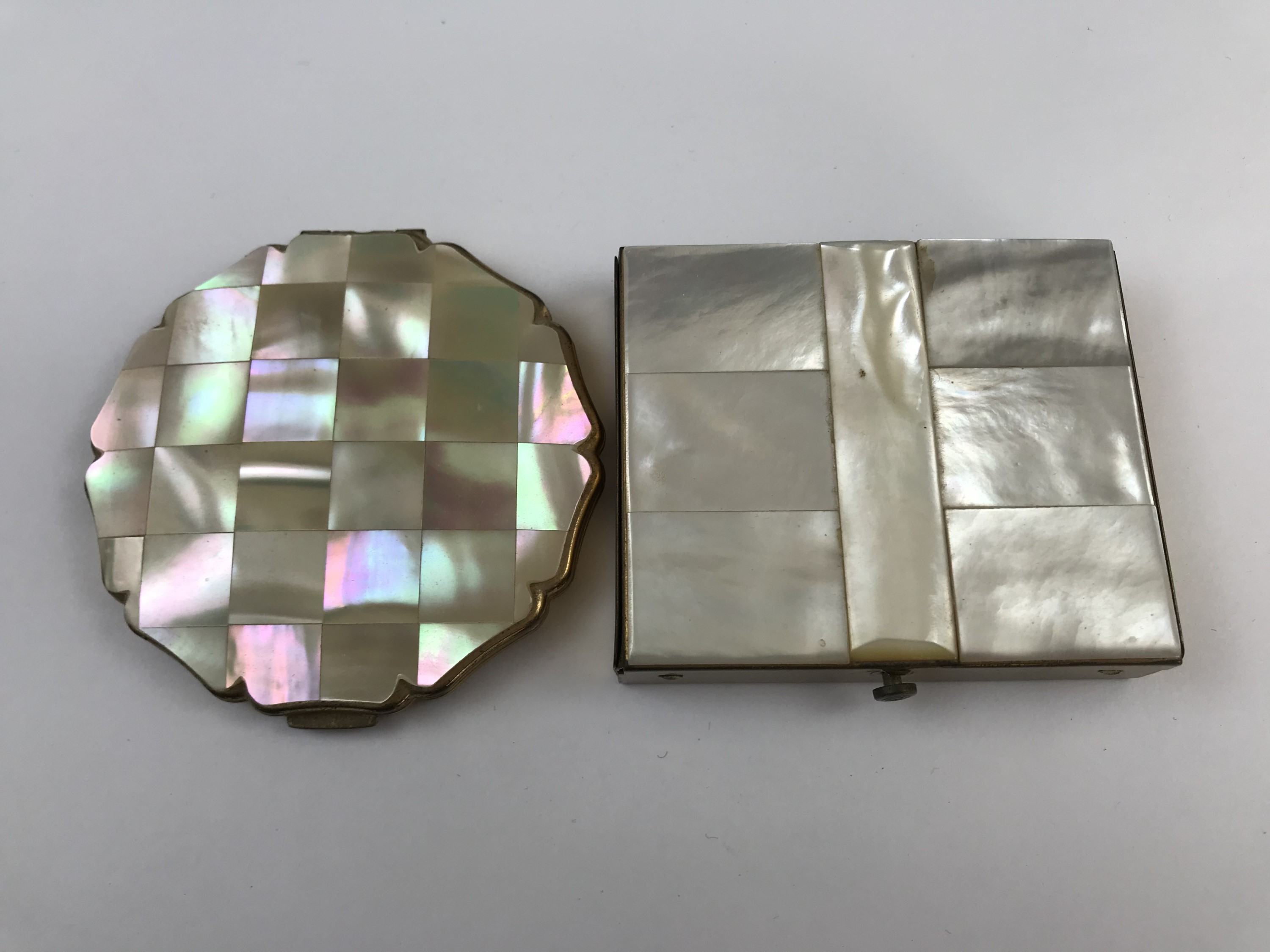 Lot 27 - A Stratton mother of pearl inlaid power compact, together with one further similar
