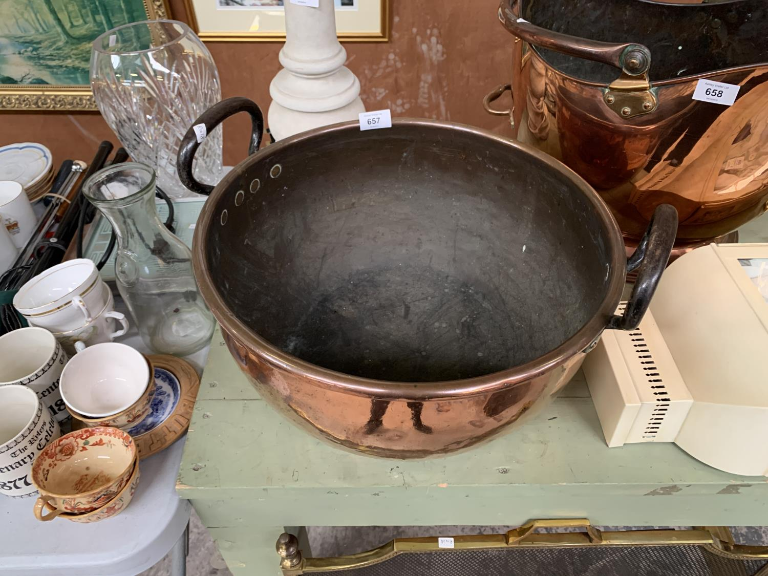 Lot 657 - A LARGE TWIN HANDLED COPPER BOWL