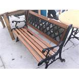 A WOODEN GARDEN BENCH WITH CAST SLATTED BACK AND ENDS