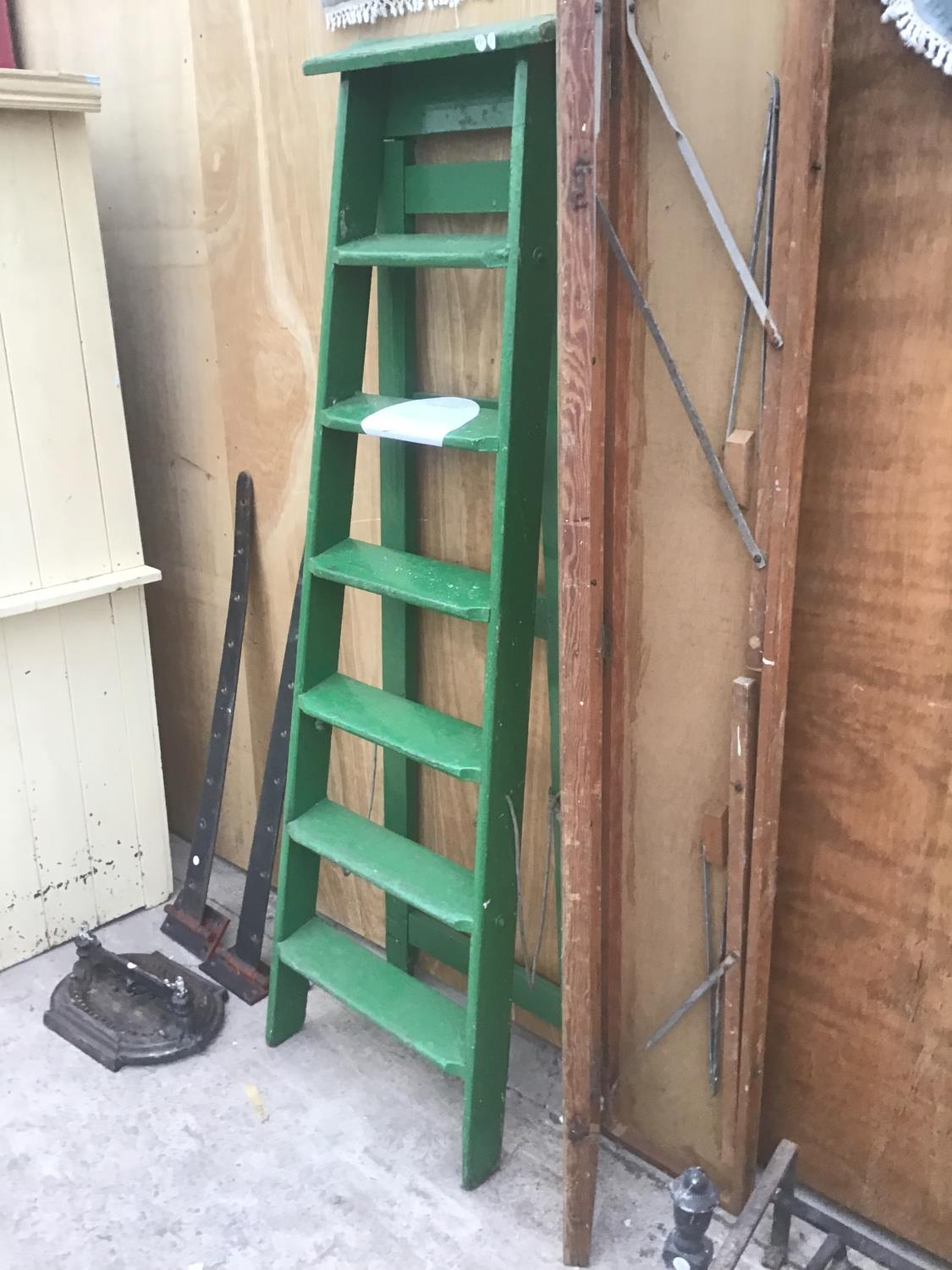 A VINTAGE SIX STEP GREEN PAINTED WOODEN STEP LADDER AND A VINTAGE FOLDING WOODEN TABLE