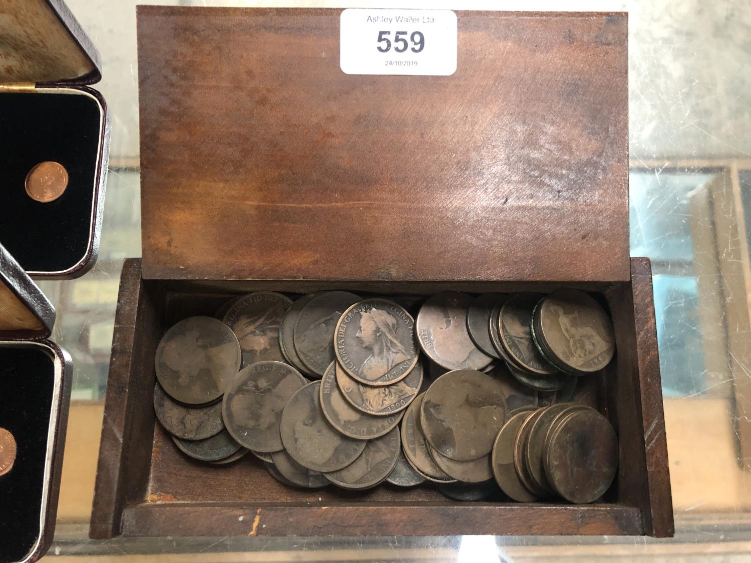 Lot 559 - A WOODEN BOX CONTAINING ASSORTED VICTORIAN PENNIES