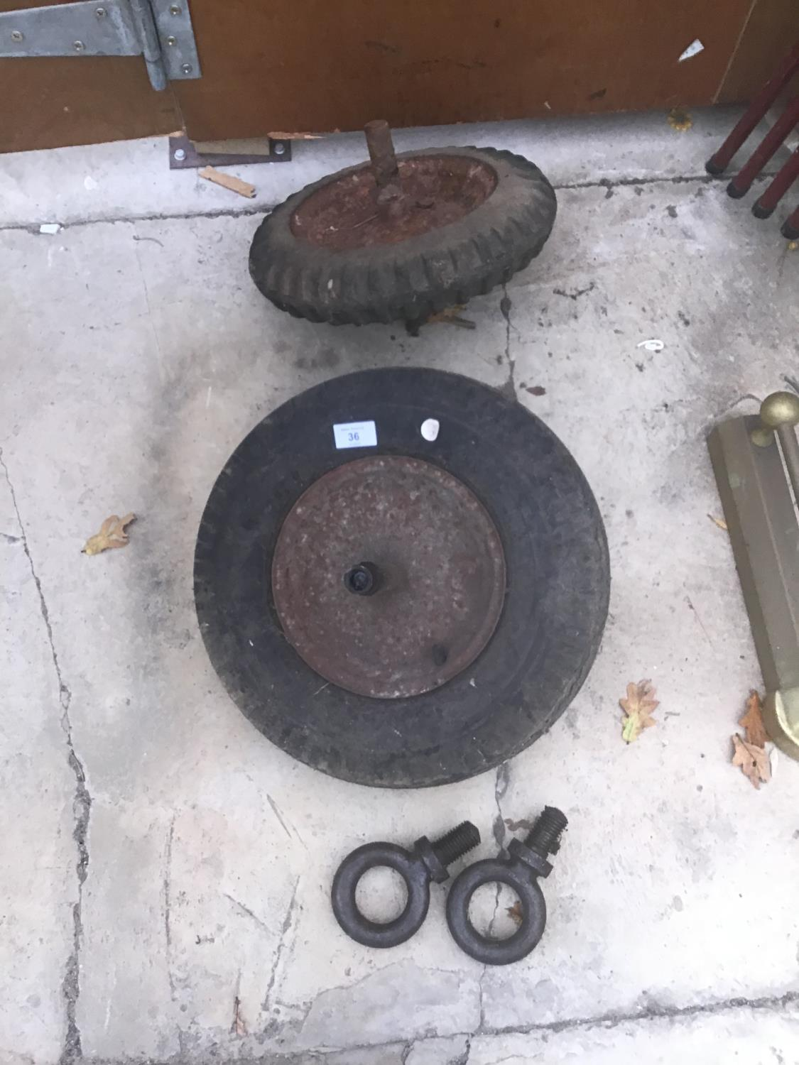 TWO BARROW WHEELS AND A PAIR OF LIFTING EYES