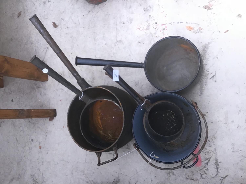 Lot 45 - FIVE VARIOUS VINTAGE CAST IRON PANS TO INCLUDE A JAM PAN