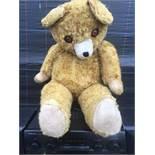 A LARGE VINTAGE TEDDY BEAR