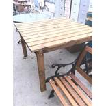 A SQUARE TOPPED WOODEN GARDEN TABLE