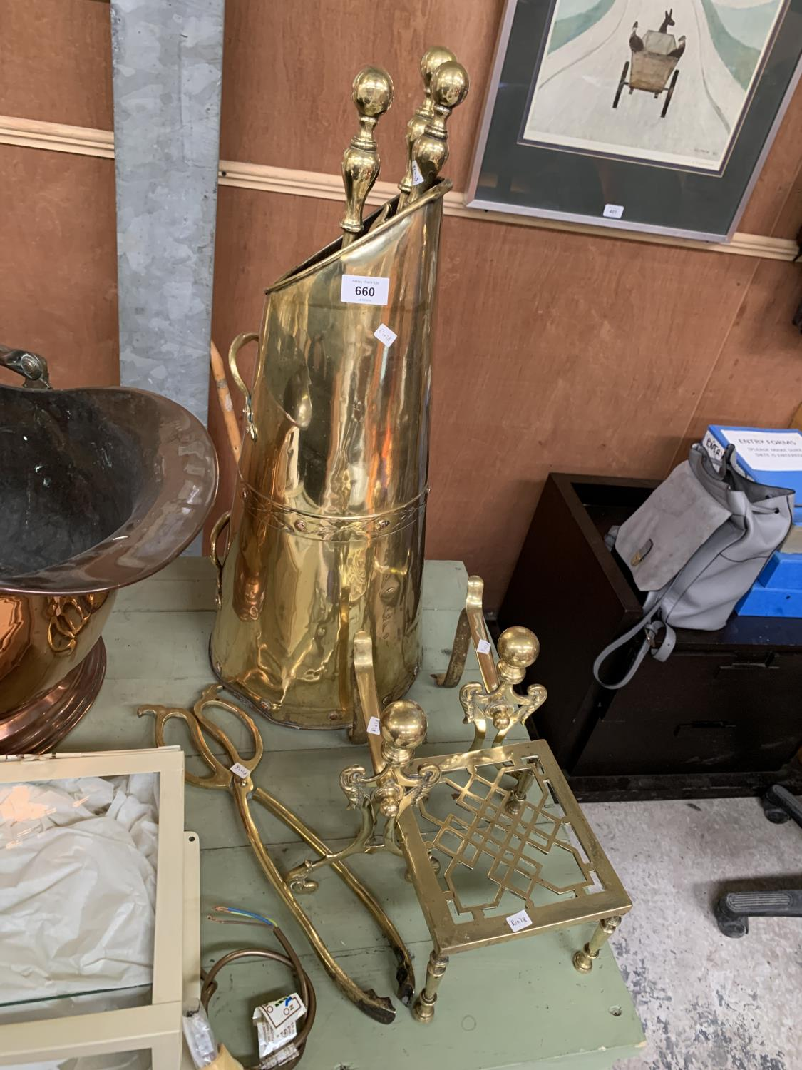 Lot 660 - A VINTAGE BRASS COMPANION SET, TRIVET STAND AND FIRE DOGS