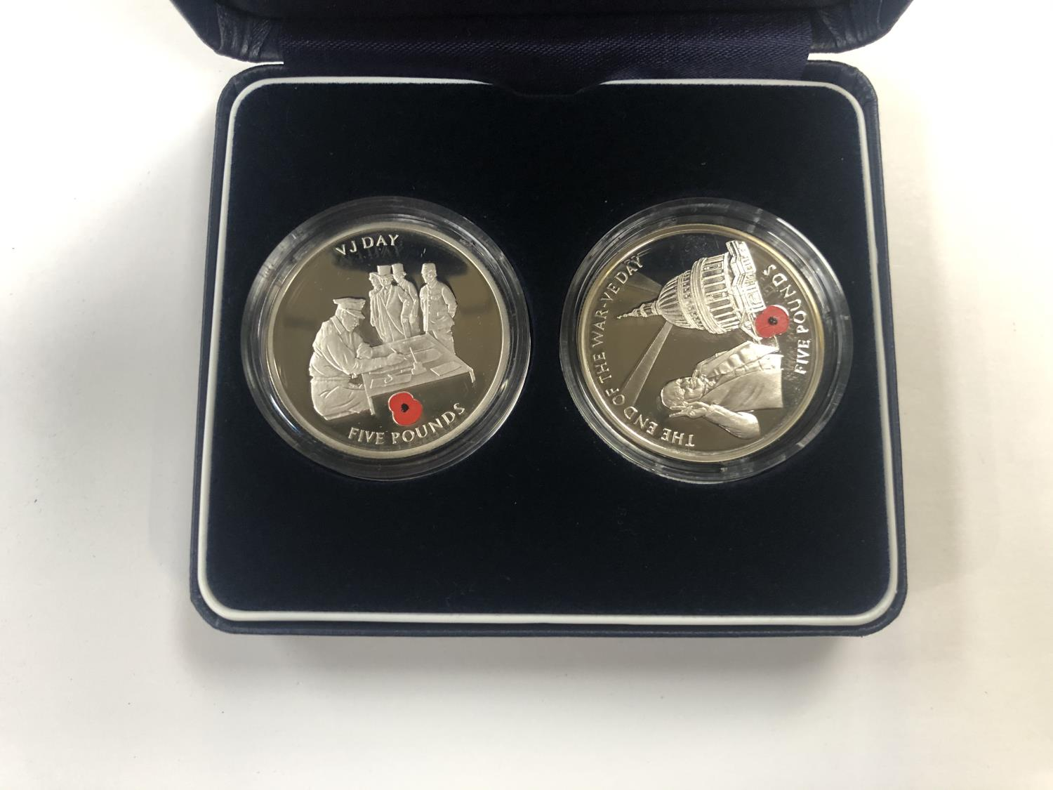 Lot 514 - WESTMINSTER THE VE DAY AND VJ DAY SILVER PROOF COIN PAIR. EACH IS ENCAPSULATED AND PRESENTED IN