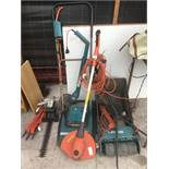 A LARGE COLLECTION OF GARDEN TOOLS TO INCLUDE A HOVER MOWER, TWO STRIMMERS, A SCARIFIER AND A