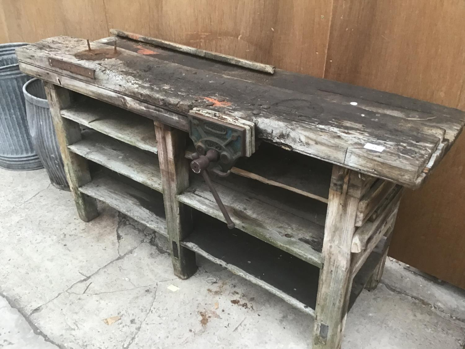 A LARGE WORKSHOP BENCH WITH A PAPAMO No 30 VICE