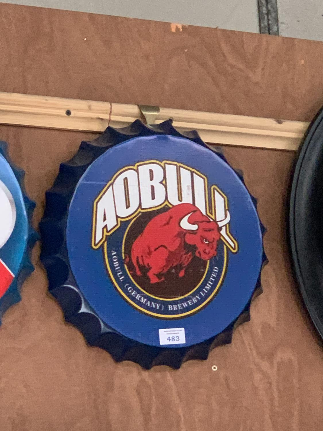 Lot 483 - A COLLECTABLE METAL BEER BOTTLE CAP 'AOBULL' SIGN