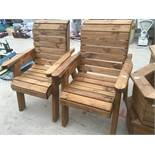 A PAIR OF WOODEN GARDEN ARM CHAIRS