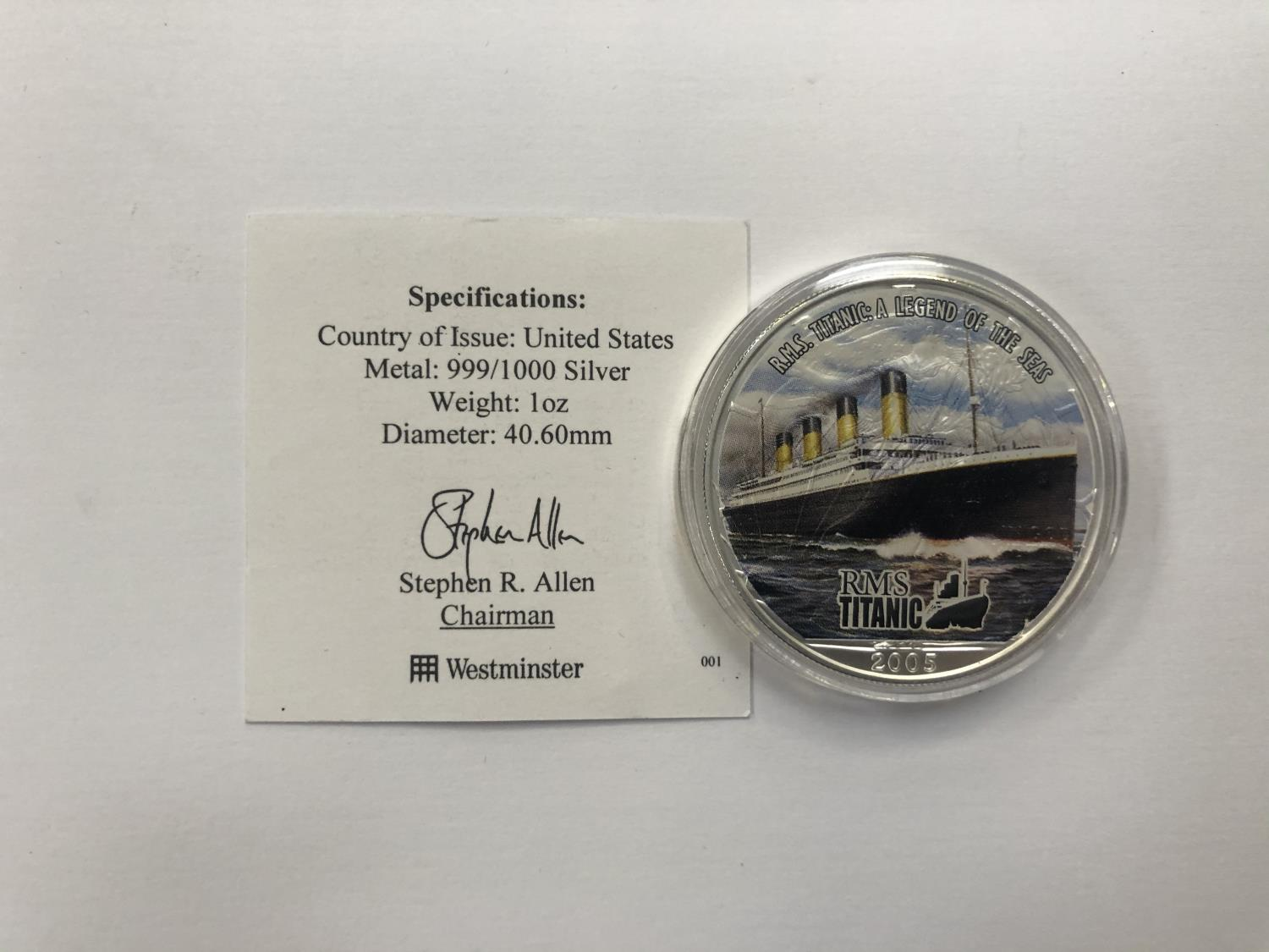 """Lot 537 - UNITED STATES """"2005 TITANIC COLOURED ONE OUNCE SILVER DOLLAR"""" ENCAPSULATED WITH C.O.A"""
