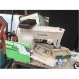 A VINTAGE SINGER SEWING MACHINE WITH BAG, PEDAL, ATTACHMENT AND PATTERNS IN WORKING ORDER