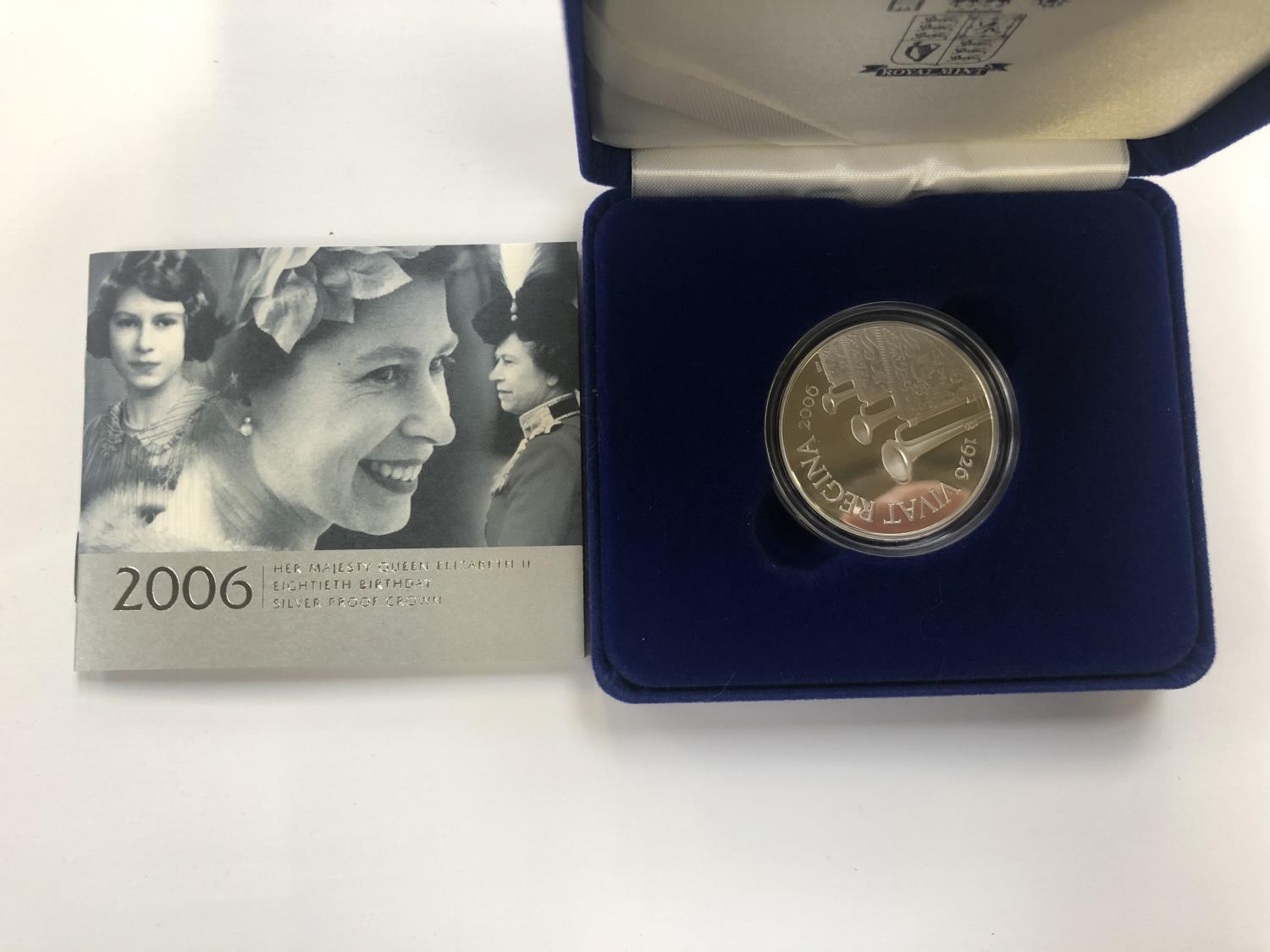 """Lot 534 - UK ROYAL MINT """"2006 EIGHTIETH BIRTHDAY SILVER PROOF CROWN"""", ENCAPSULATED AND BOXED WITH C.O.A"""