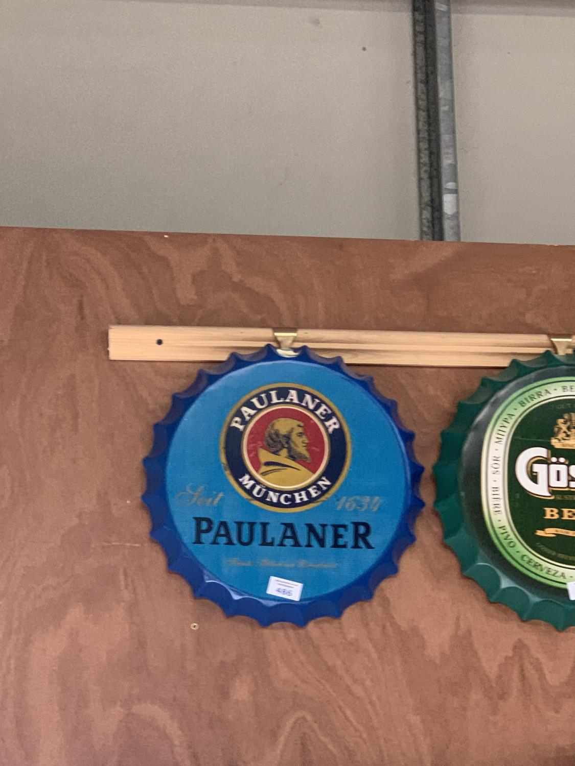 Lot 486 - A COLLECTABLE METAL BEER BOTTLE CAP 'PAULANER' SIGN