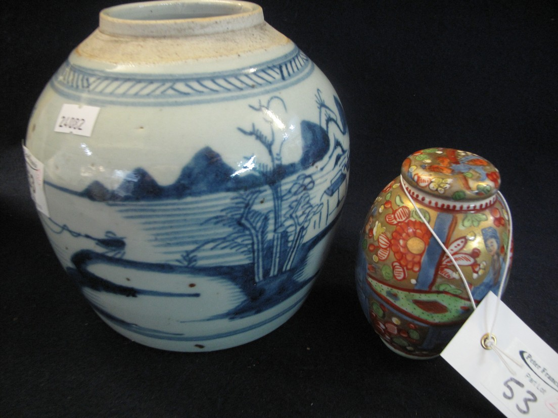 Chinese porcelain lidded pot of ovoid form probably clobbered in iron red and green enamels,