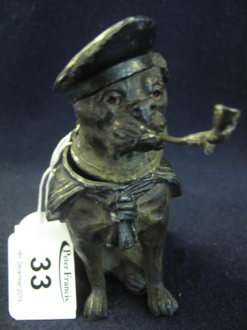 Novelty white metal inkwell in the form of a seated boxer dog smoking a pipe and wearing a navel