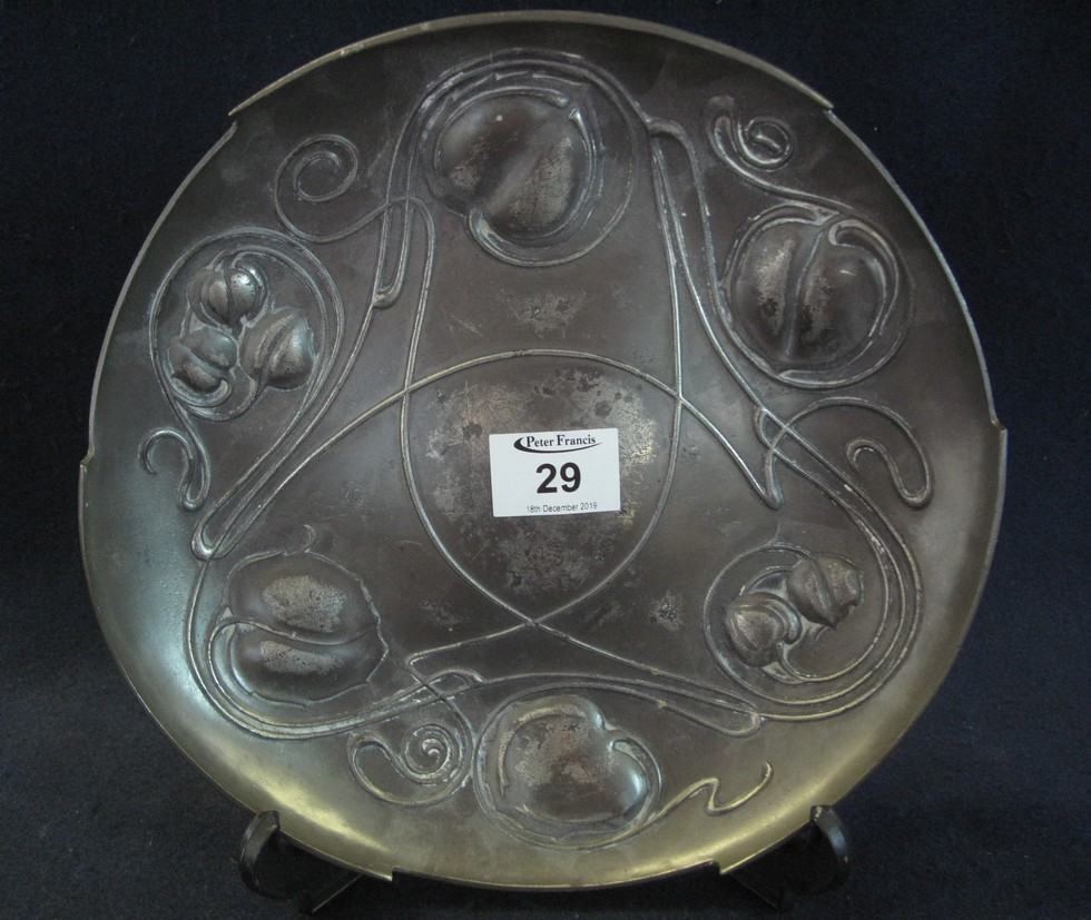Lot 29 - Art Nouveau pewter circular dish with stylised entwined leaf decoration,