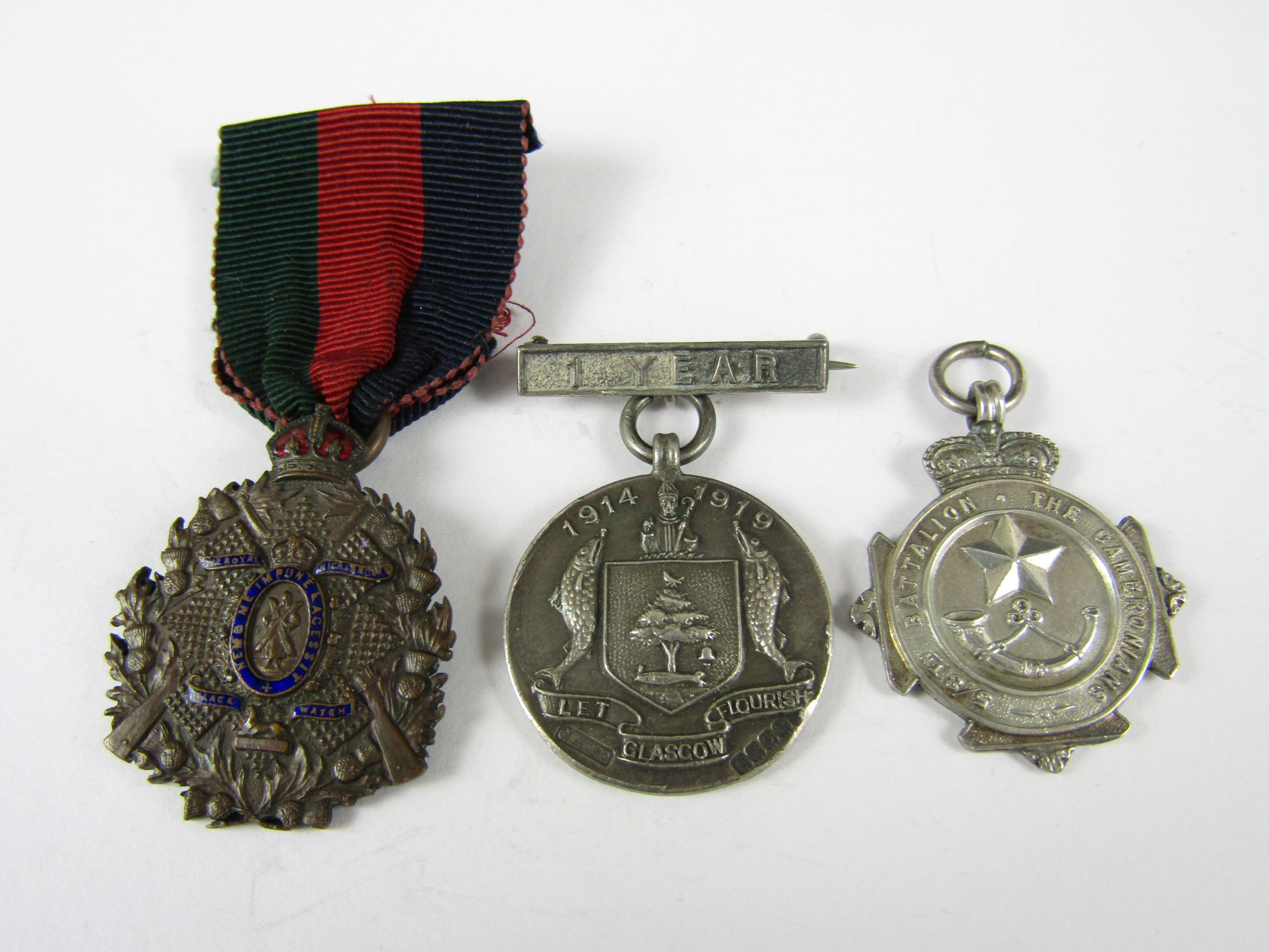 Lot 52 - A silver 5th / 8th Battalion The Cameronians fob, together with a silver Glasgow Constabulary