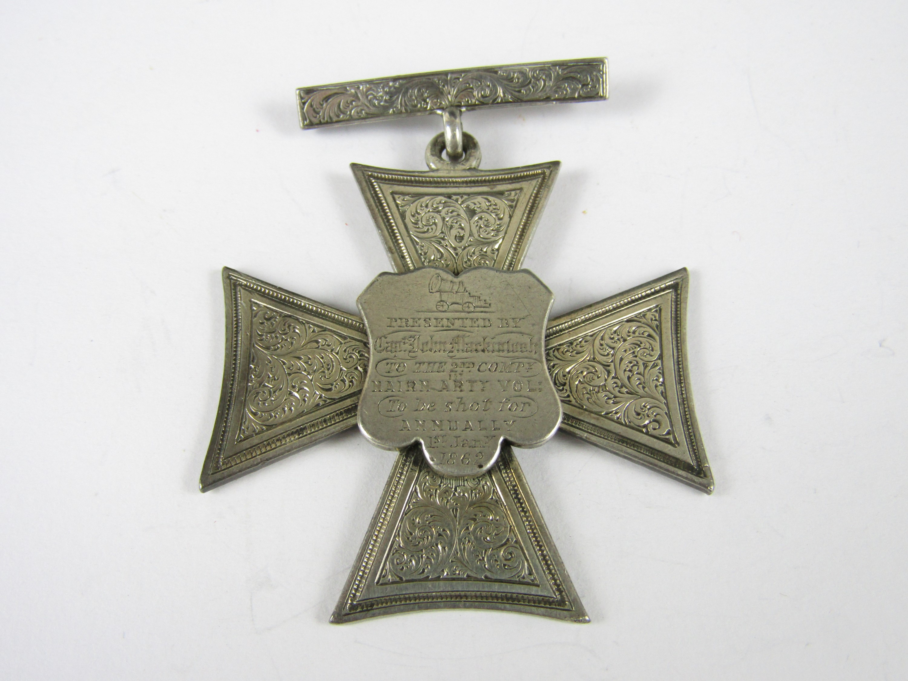 Lot 50 - A large Victorian prize medallion presented by Captain John MackIntosh to the 2nd Company 1st