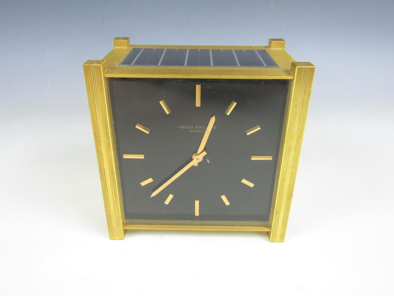 A patek philippe solar powered desk clock quartz movement square lot 701 a patek philippe solar powered desk clock quartz movement square face amipublicfo Gallery