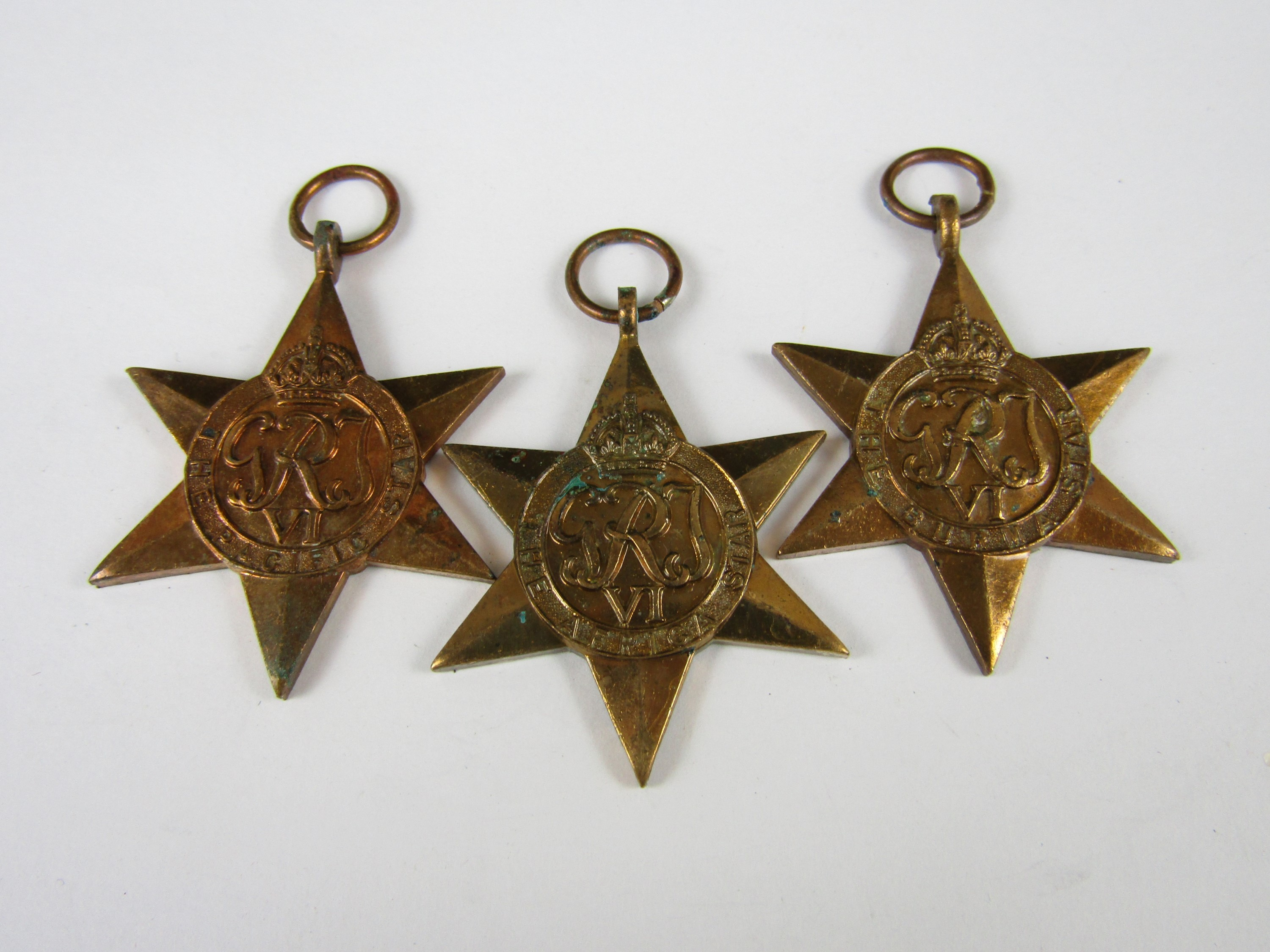 Lot 14 - An Africa Star, engraved to 159329 Capt N C Gordon, R Signals, together with un-engraved Burma and